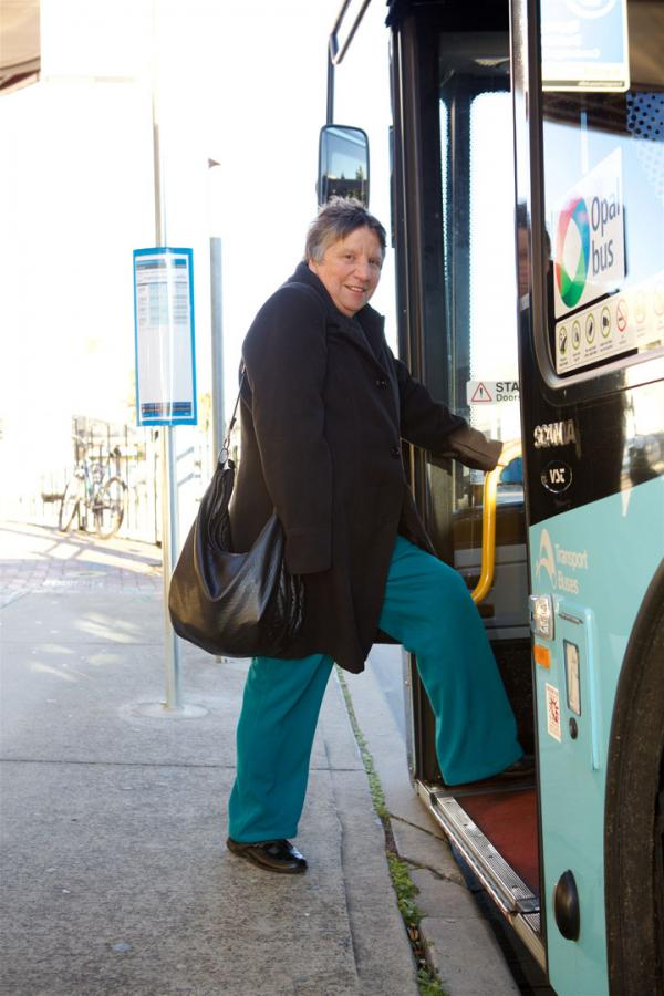 Older lady getting on bus